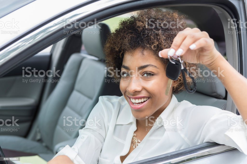 Young businesswoman is excited about new car stock photo