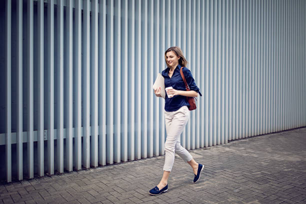 Young businesswoman is running to her office stock photo