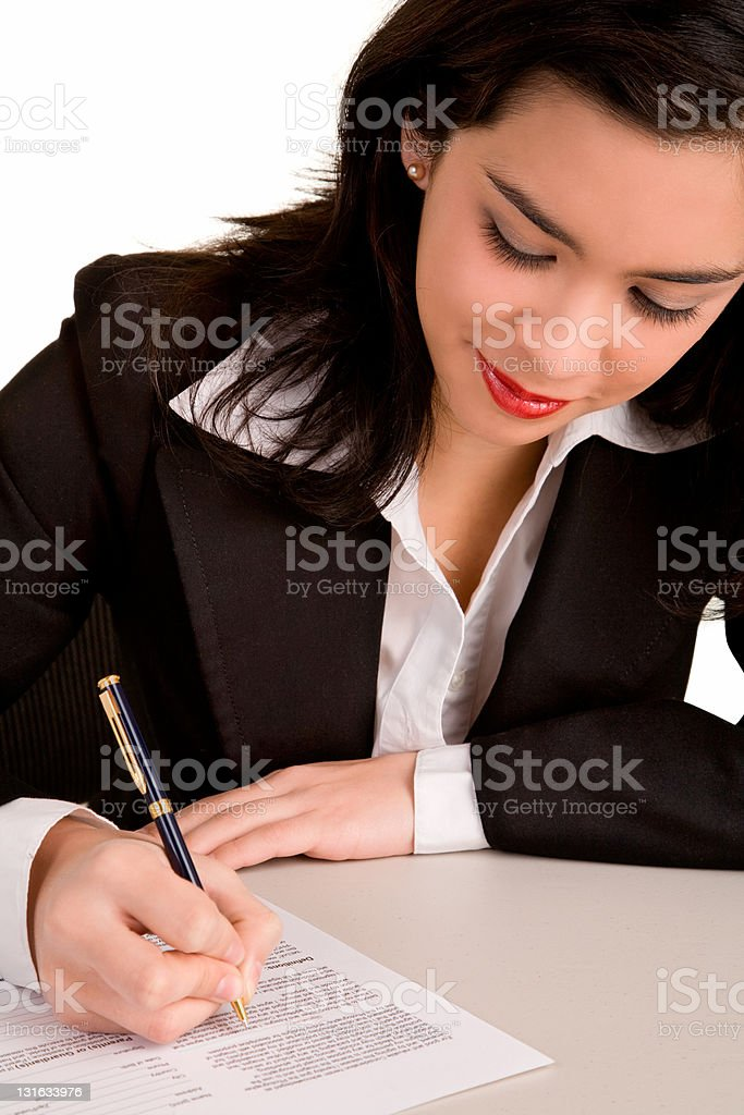Young Businesswoman is Signing a Document royalty-free stock photo