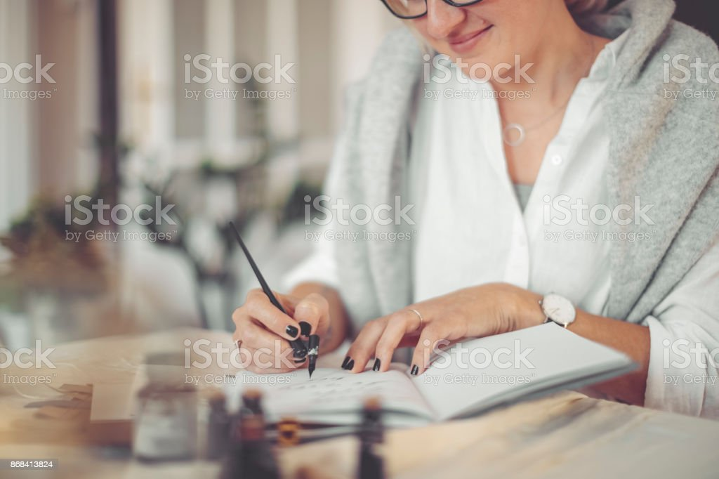 Young businesswoman is writing in a personal organizer stock photo
