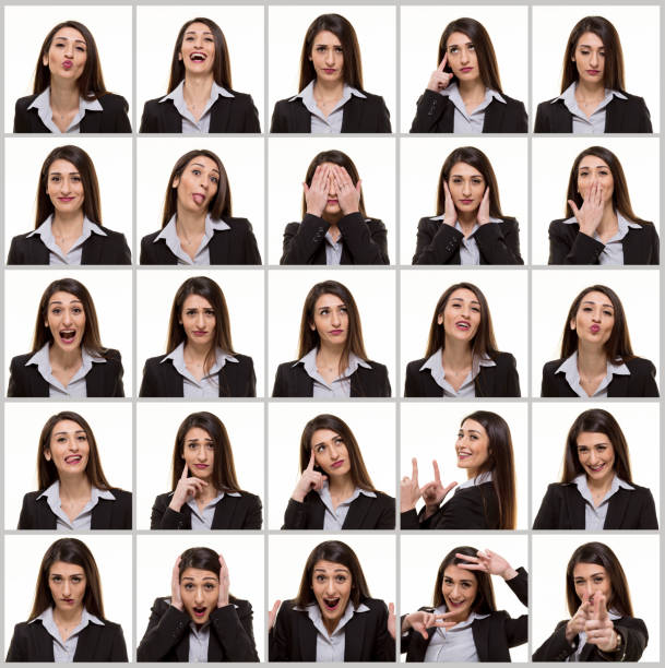 Young businesswoman making facial expressions stock photo