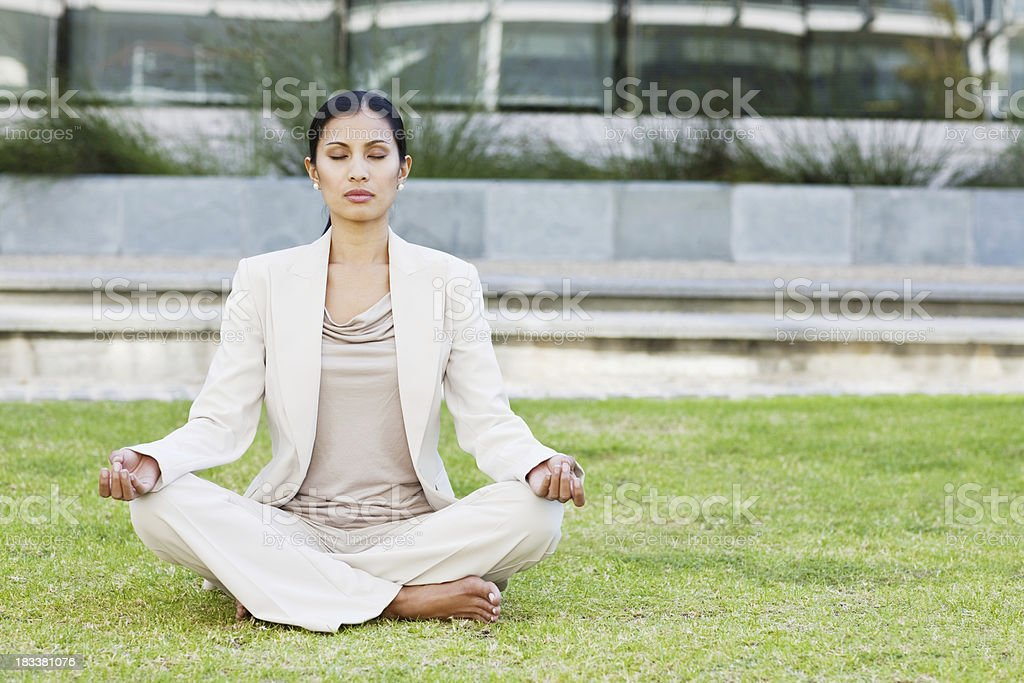 Young businesswoman meditating royalty-free stock photo