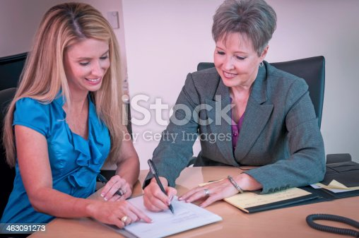istock Young businesswoman mentored by the senior female executive - II 463091273