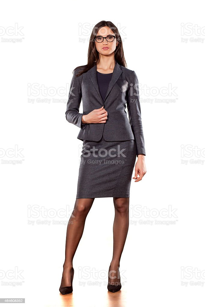 Young businesswoman posing on white background stock photo