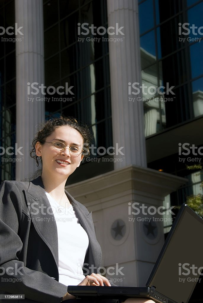 Young businesswoman posing outside a building stock photo