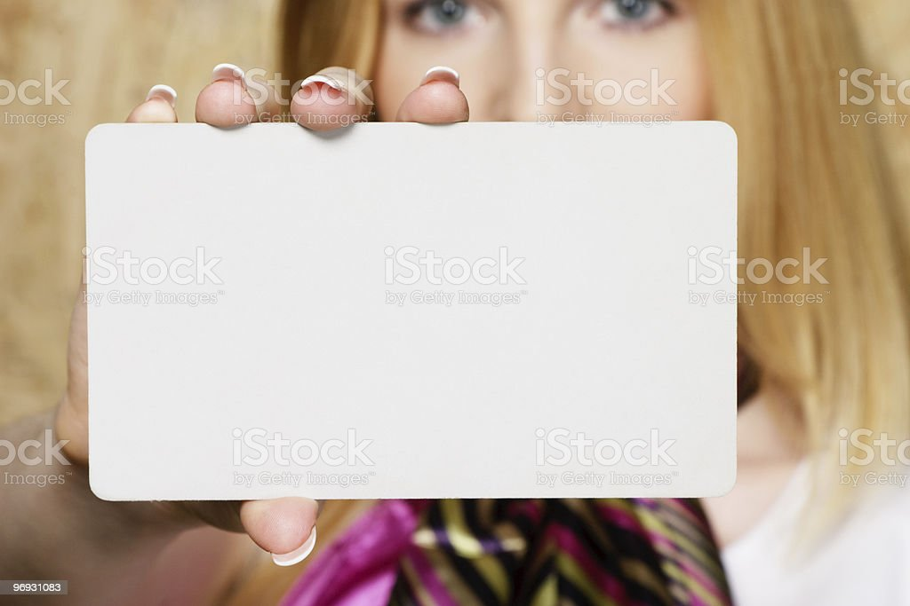 Young businesswoman presenting businesscard royalty-free stock photo