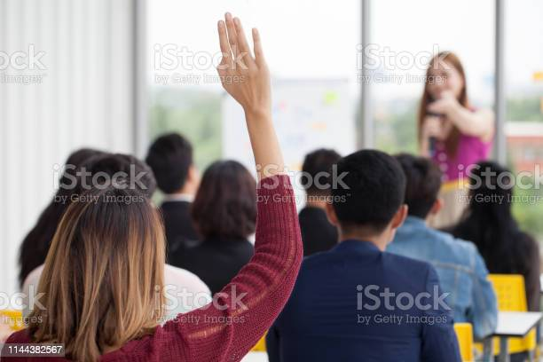 Young businesswoman raising hand to question from speaker in seminar picture id1144382567?b=1&k=6&m=1144382567&s=612x612&h=lx cukl 4b8dotxkwugesot jmgni9doccfbb2thlz8=