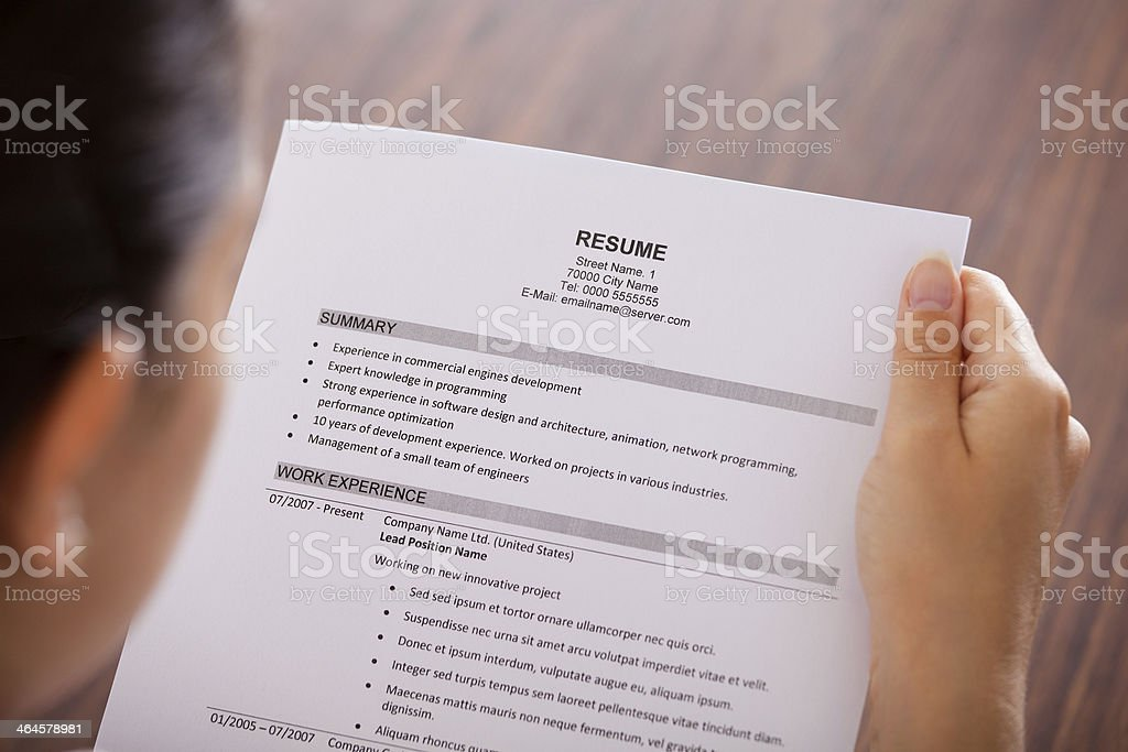 Young Businesswoman Reading Resume stock photo