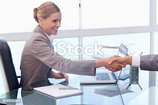 istock Young businesswoman receiving a customer 826989354
