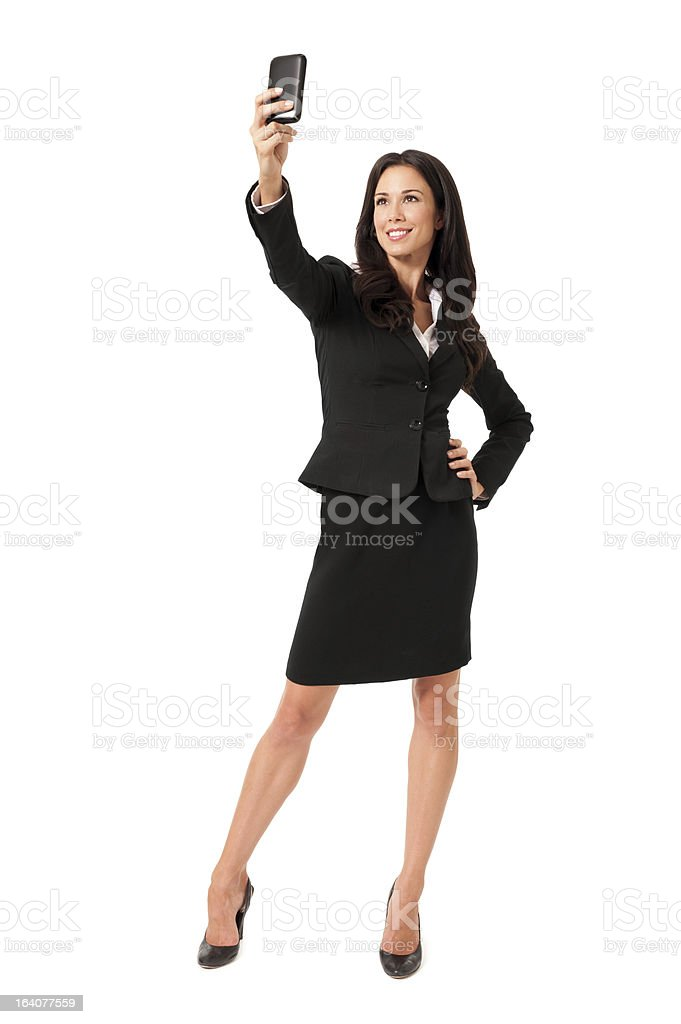 Young Businesswoman Self Portrait with Mobile Phone on White royalty-free stock photo