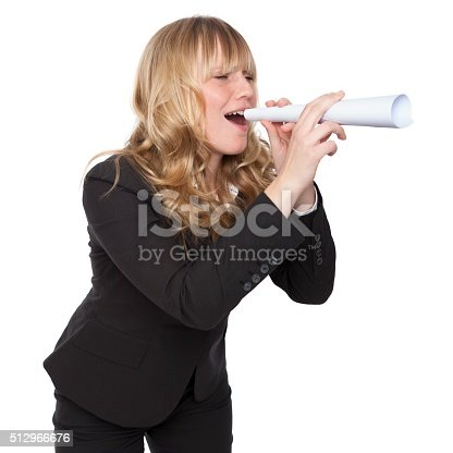 istock Young businesswoman shouting through a paper tube 512966676