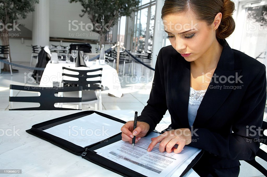 Young businesswoman signing a contract royalty-free stock photo