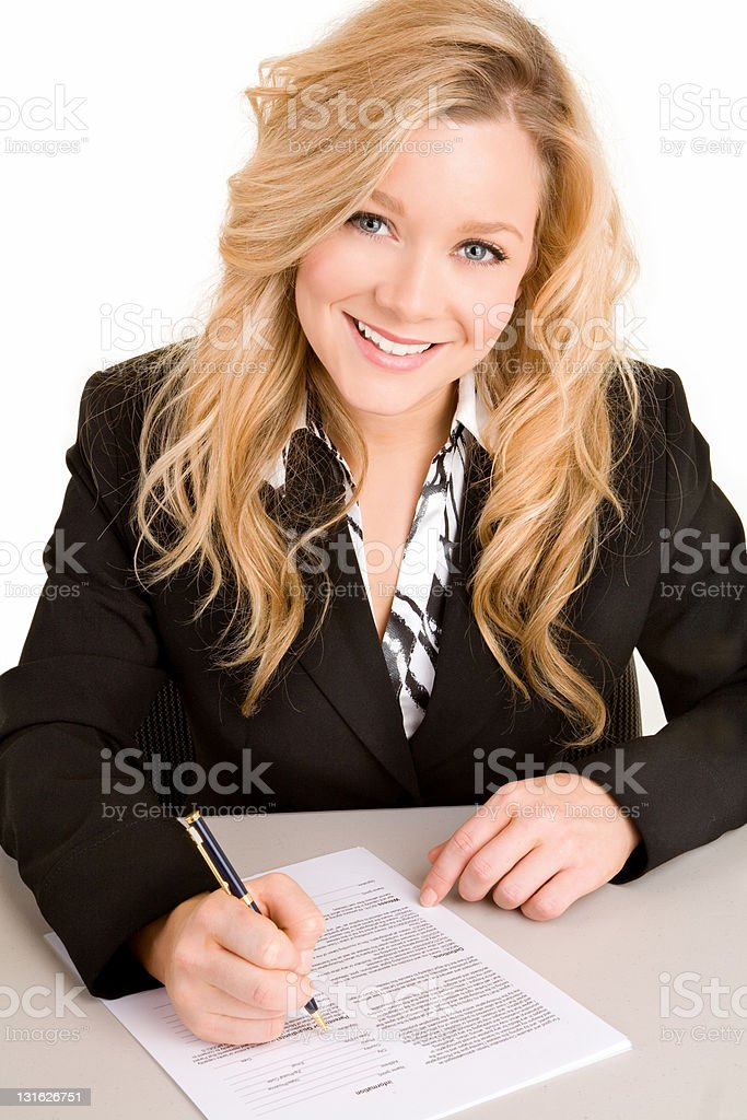 Young Businesswoman Signing a Document royalty-free stock photo