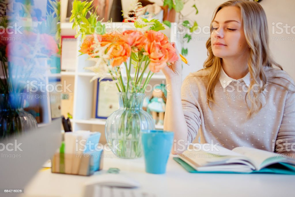 Young businesswoman sitting at desk and working. Beautiful woman and her workplace royalty-free stock photo