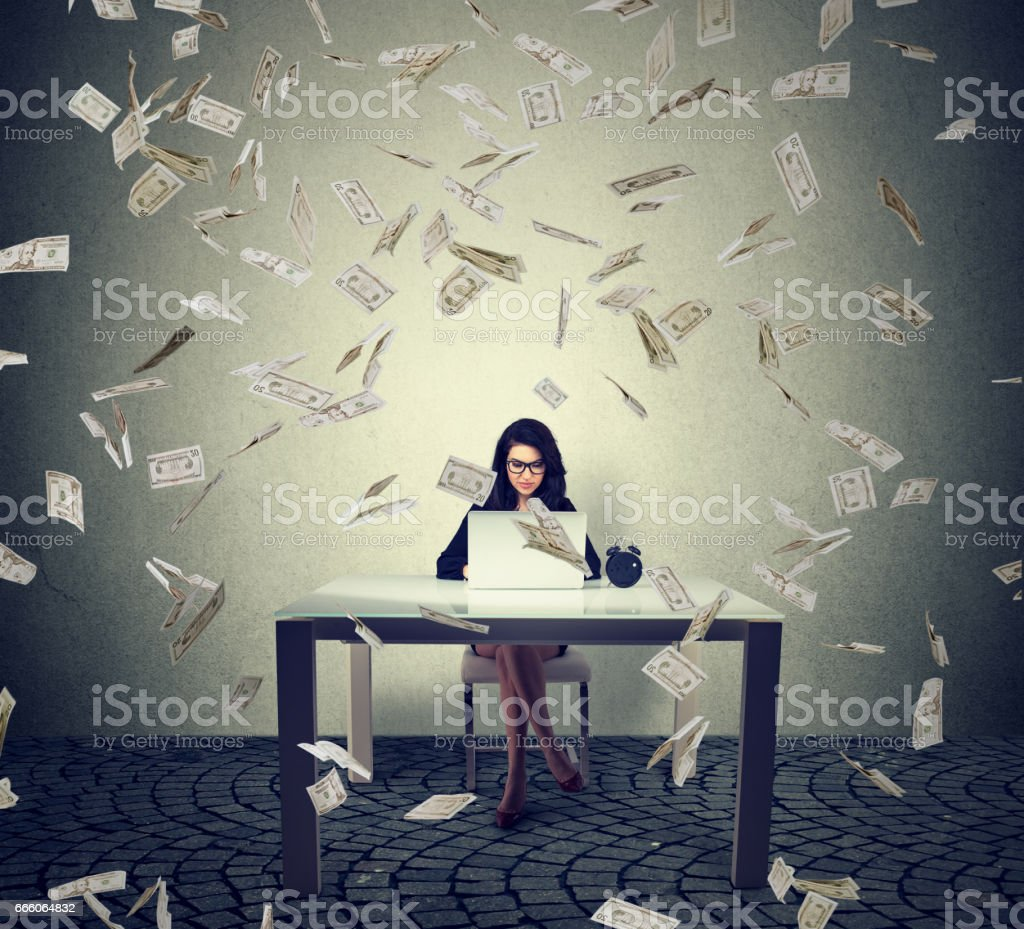 young businesswoman sitting with her laptop in the office stock photo