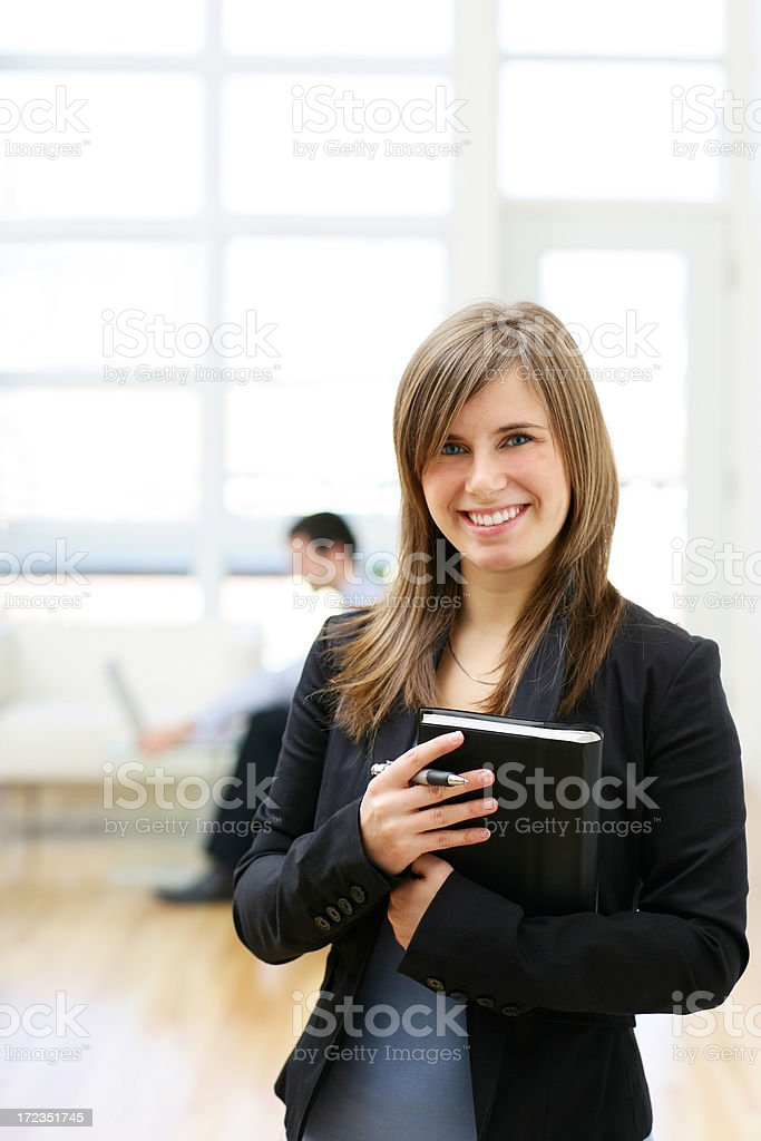 Young businesswoman smiling royalty-free stock photo