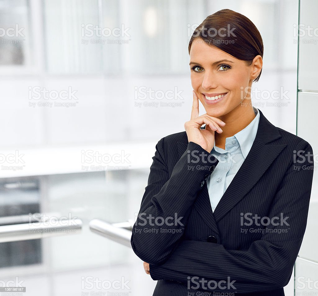 Young businesswoman standing in the office royalty-free stock photo