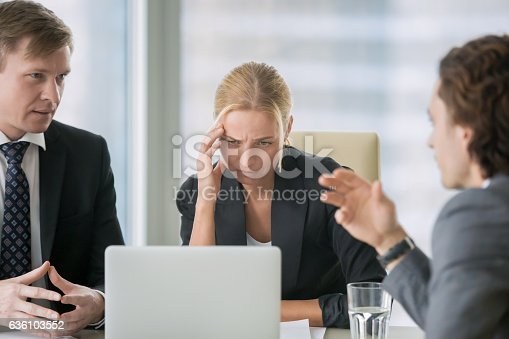 istock Young businesswoman suffering from headache 636103552