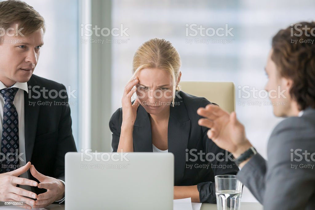Young businesswoman suffering from headache stock photo