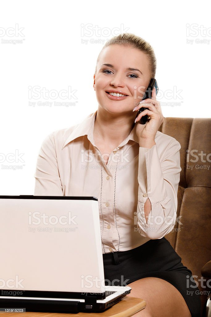 Young businesswoman talking on cellphone stock photo