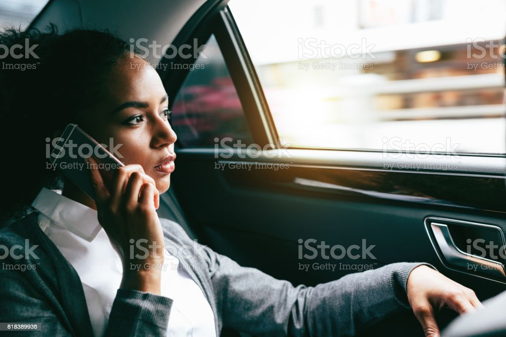 Young businesswoman talking on mobile phone stock photo