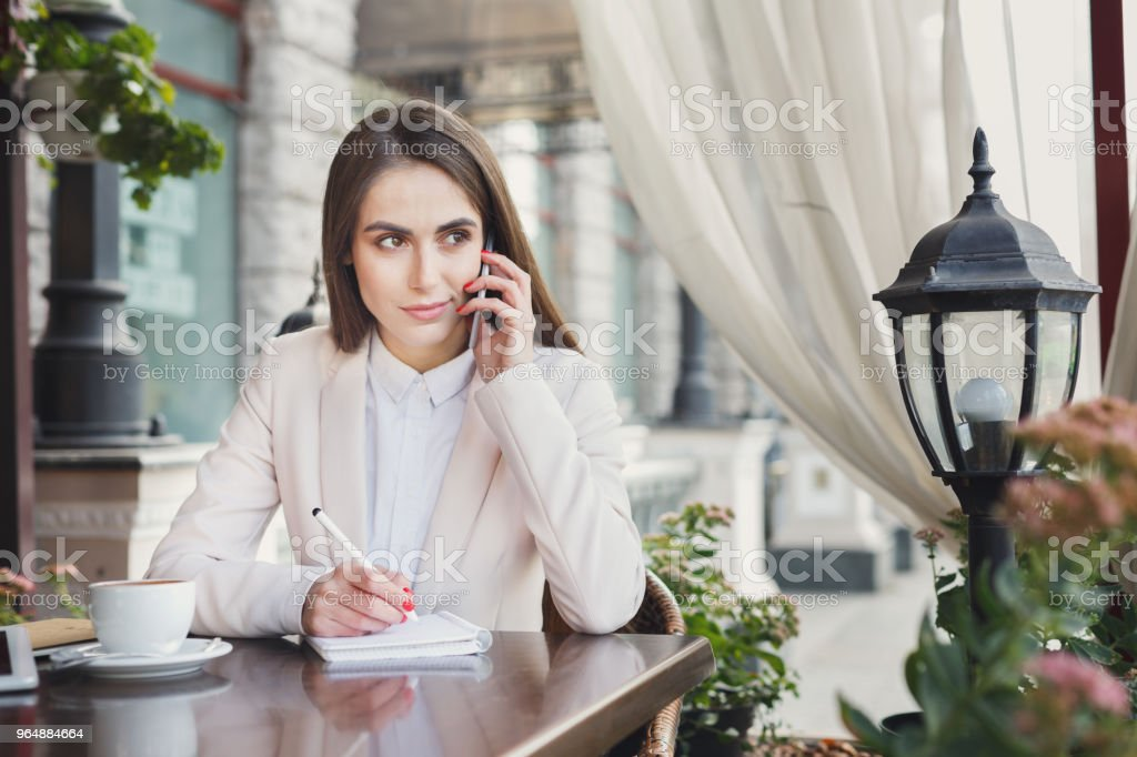Young businesswoman talking on smartphone royalty-free stock photo