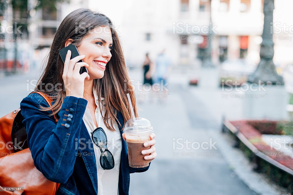 Young businesswoman talking on the smart phone royalty-free stock photo