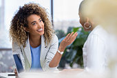 istock Young businesswoman talks with colleague 1034426844