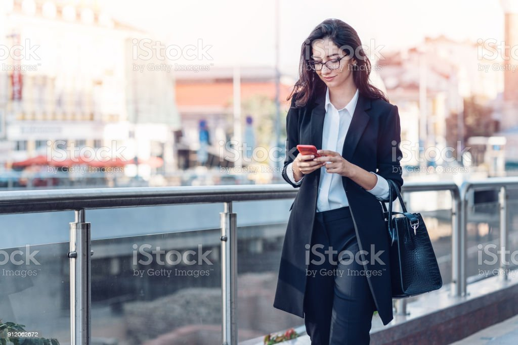 Young businesswoman texting on her phone stock photo