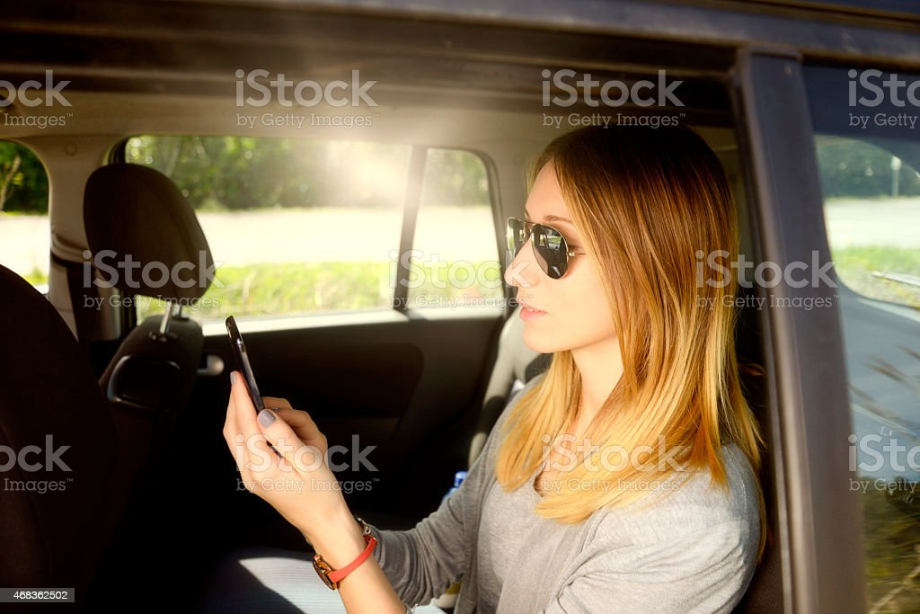 Young Businesswoman Texting royalty-free stock photo