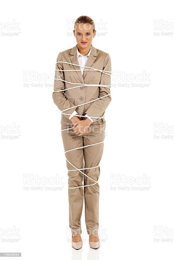 young businesswoman tied up by rope stock photo