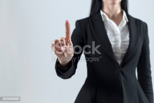 515789546istockphoto Young businesswoman touch screen consept 520593092