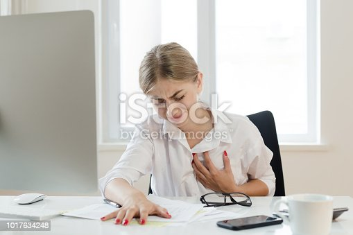 Young businesswoman touching her chest