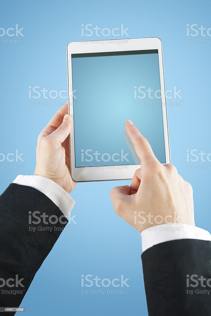 Young businesswoman touching screen on digital tablet computer royalty-free stock photo