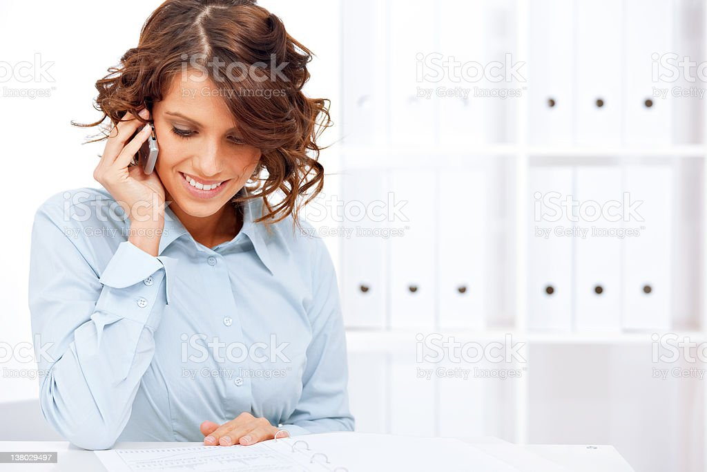Young businesswoman using cellphone stock photo