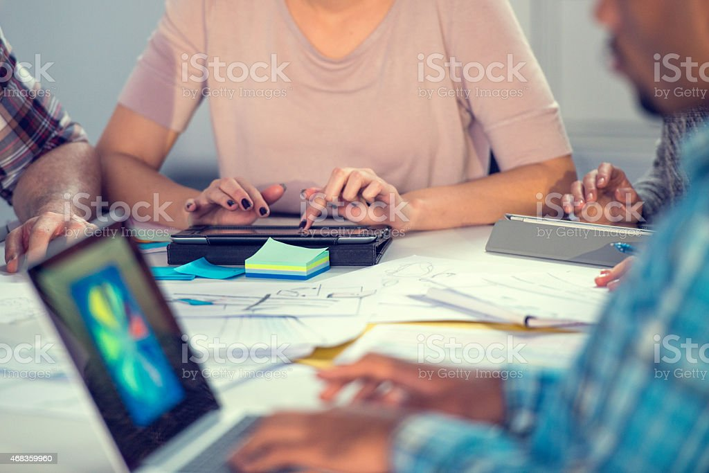 Young Businesswoman Using Digital Tablet During Board Meeting royalty-free stock photo