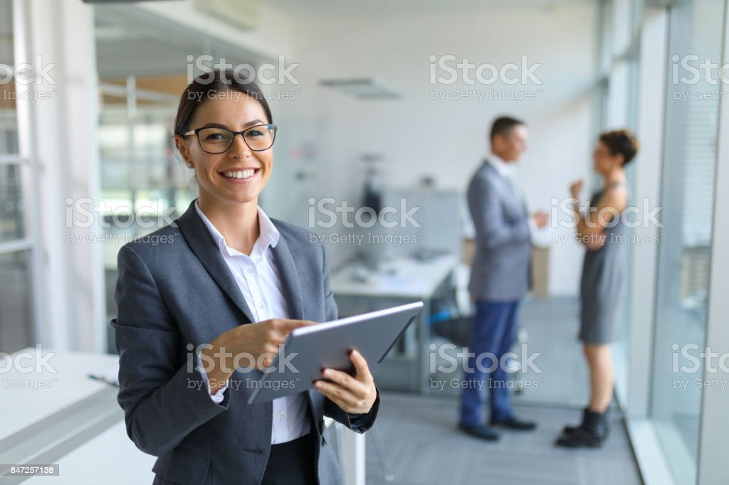 Young businesswoman using digital tablet in the office stock photo