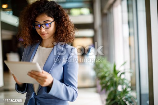 912944158istockphoto Young businesswoman using digital tablet indoors 1172803265