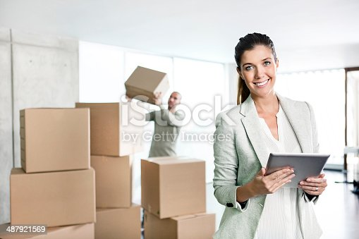 istock Young businesswoman using digital tablet 487921569