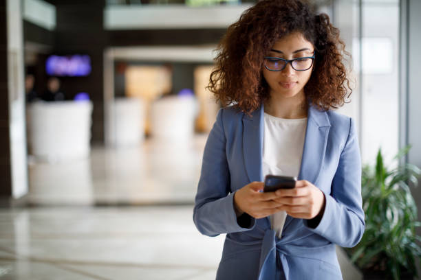 Young businesswoman using mobile phone stock photo