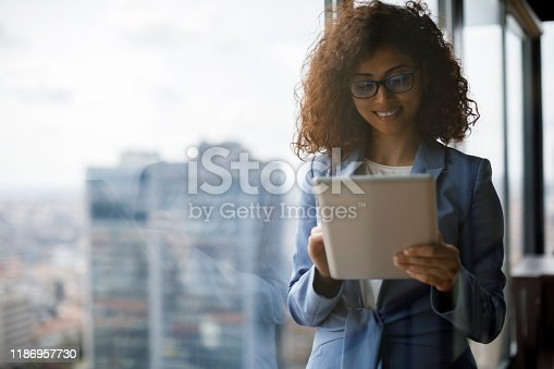 912944158istockphoto Young businesswoman using using digital tablet 1186957730