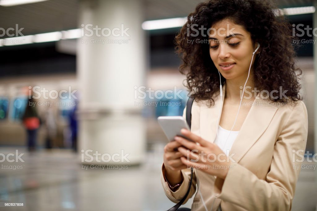 Young businesswoman waiting at subway station Young businesswoman waiting at subway station Adult Stock Photo