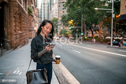 istock Young businesswoman waiting for taxi in Sydney 924155950