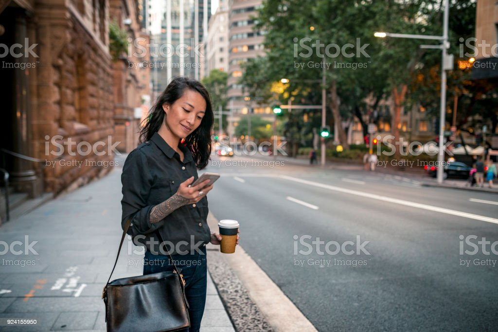 Young businesswoman waiting for taxi in Sydney stock photo