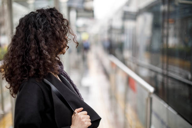 Young businesswoman waiting for train at the satation stock photo