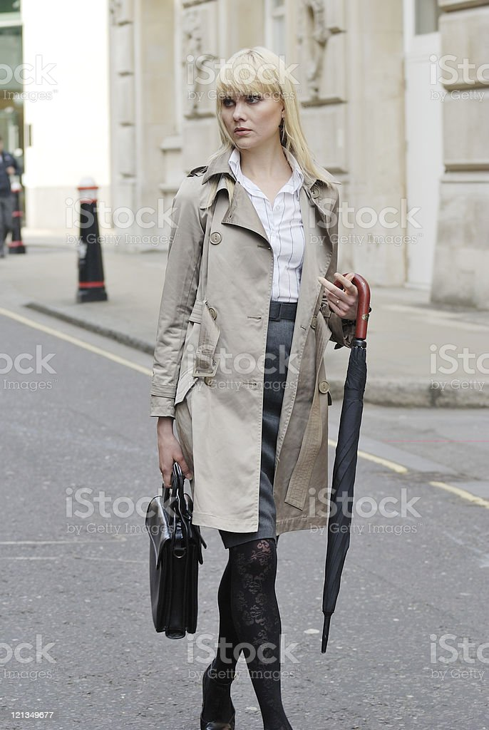Young businesswoman walking down street stock photo