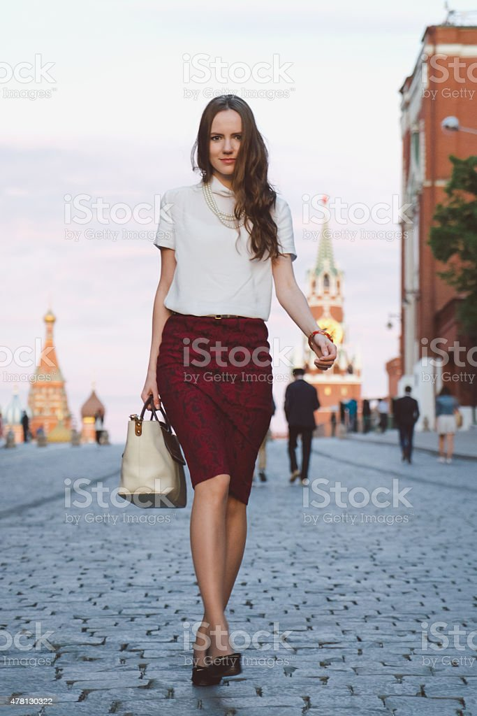 Young Businesswoman Walking In A City Street stock photo