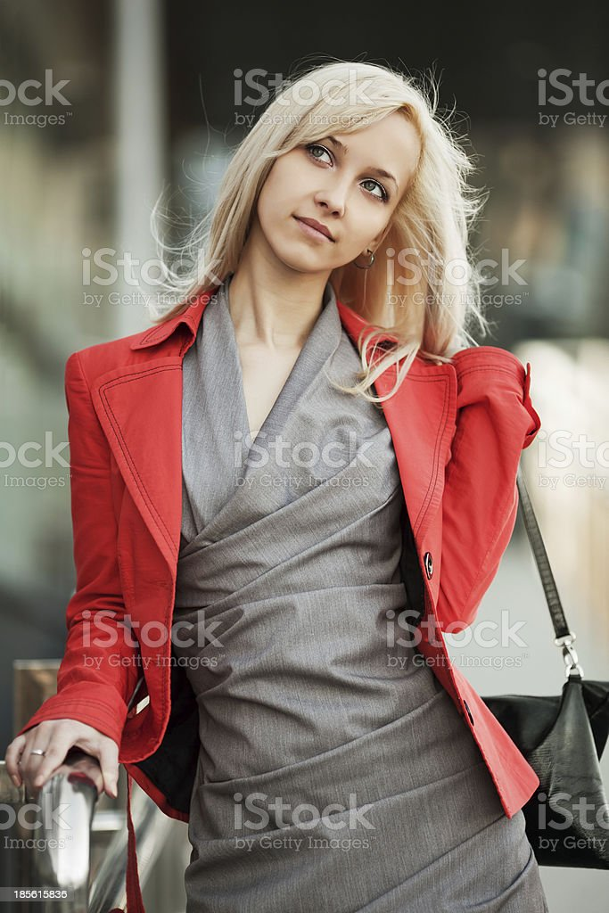 Young businesswoman walking on the city street royalty-free stock photo