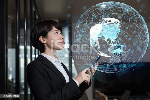 1127070103 istock photo Young businesswoman watching GUI of world map. GLobal business concept. 929959566