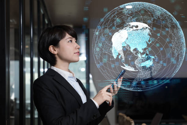 young businesswoman watching gui of world map. global business concept. - business woman hologram imagens e fotografias de stock